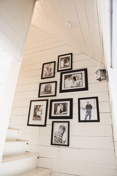 I like the photo display of family on a wall by stairs. Joanna Gaines's Blog | HGTV Fixer Upper | Magnolia Homes