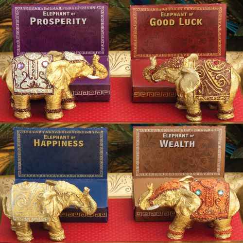 """Give your guests a little bit of good fortune at your wedding with these decorative gold mini elephant favors.  Great for Indian or Asian weddings or any party where you'd like to bring a bit of good luck to your guests.  Made of sturdy poly resin with glitter details and rhinestones, in the shape of a decorated gold elephant with its trunk up for luck, these lucky elephants come in a set of 4 (one for Luck, Wealth, Prosperity, and Happiness). Each measures 3 1/4"""" long x 2 1/8"""" tall x 2""""…"""
