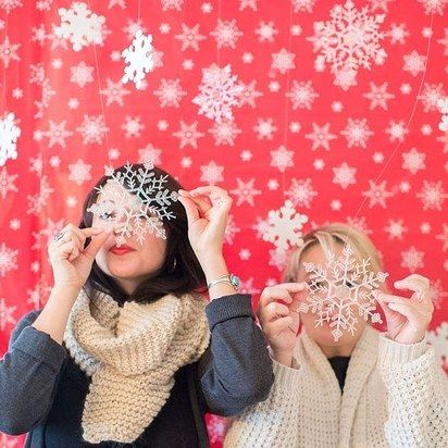 Wrapping paper makes a great backdrop. | How To Create A Quick And Easy Photo Booth For Awesome Family Photos