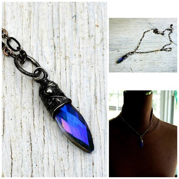 Faceted iridescent glass pendant. Great to wear alone or layered with others.