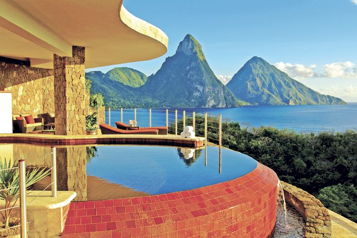 JADE MOUNTAIN is St. Lucia's only resort property with the iconic view of both the Piti and Gros Piton mountains floating upon the #Caribbean Sea. The location of the property is unsurpassed, rising majestically above the private estate of ANSE CHASTANET with 600 lush tropical acres bordering two soft, sand Caribbean beaches with pristine coral reefs just off shore. Part of the estate is the historical plantation of Anse Mamin and Emerald Estate where the resort grows its own organic…