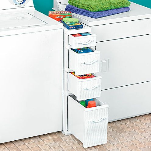 Between Washer Dryer Drawers, contemporary storage and organization. I still prefer the heavy detergent bottles to be on a shelf above. Easier on the back
