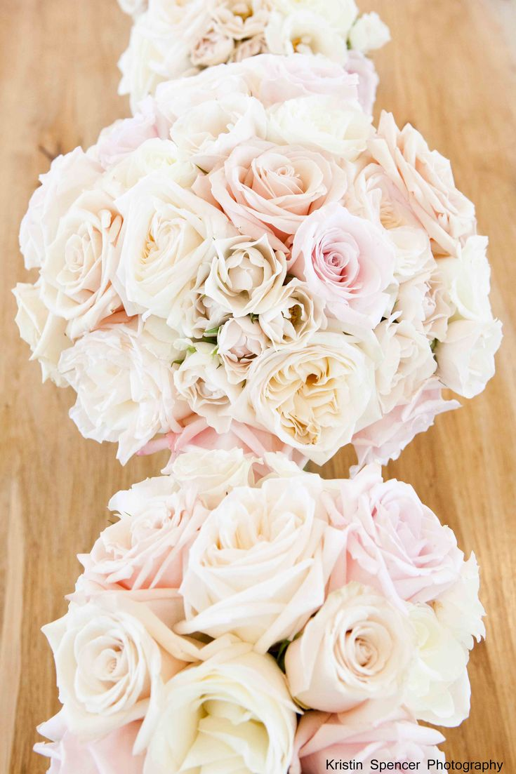 bridesmaids will carry cream hydrangeas ivory garden roses and blush spray roses wrapped in navy and white striped ribbon