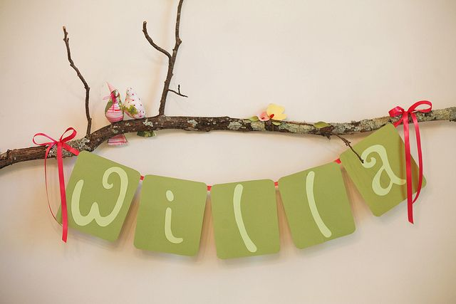 banner on a branch ... this would be adorable for a baby shower