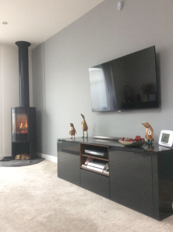 Recently decorated lounge complete with corner log burner