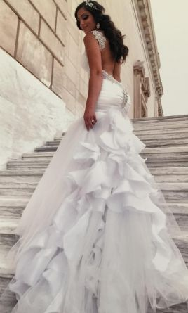 Inbal Dror  real bride. This wedding dress is for sale at 47% off retail.