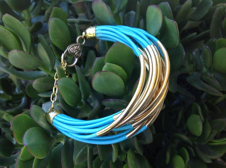 Turquoise Indian Leather with Gold Tube Beads.