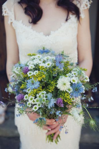 """I love British meadow flowers and didn't want anything that was imported or out of season. We also visited a wholesaler to pick up a few sprays of daisies and sunflowers to bulk up the displays, and craspedia for the buttonholes."