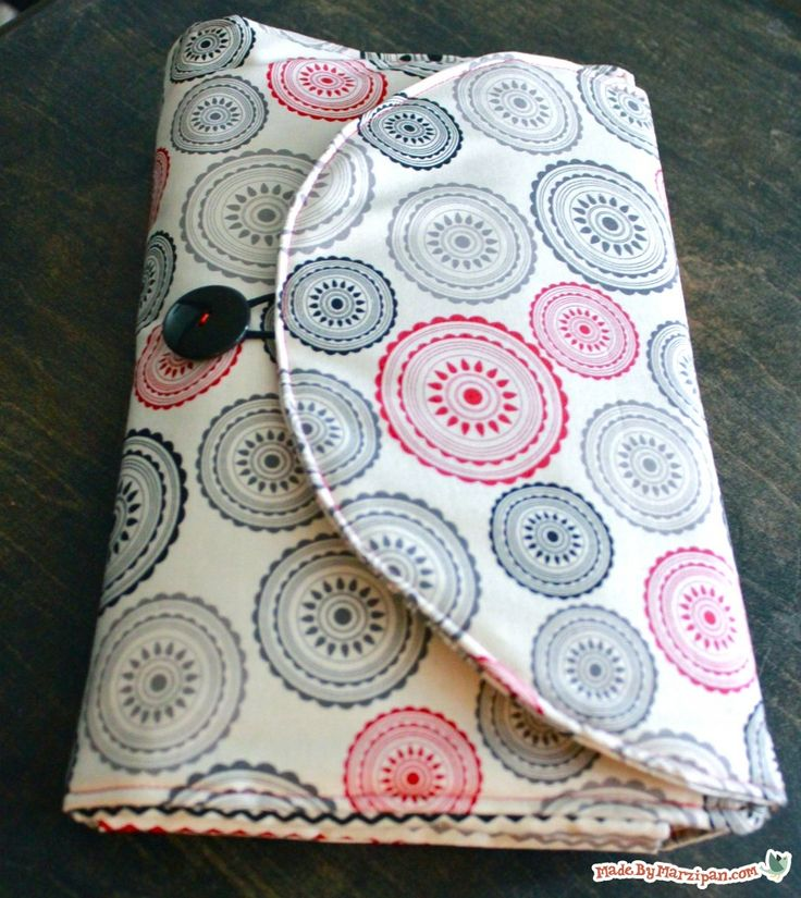 Made By Marzipan. Diaper mat with super convenient pockets to hold needed items. Looks easy enough to make.(I hope)