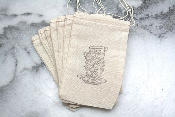 Muslin tea party favor bags, 3x5. Set of 20.  Vintage style teacups in chocolate brown on natural white cotton.. $20.00, via Etsy.