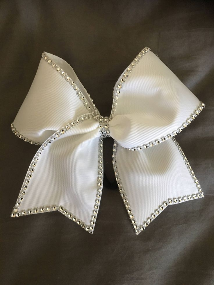 A personal favorite from my Etsy shop https://www.etsy.com/listing/535450872/classic-rhinestones-white-cheer-bow