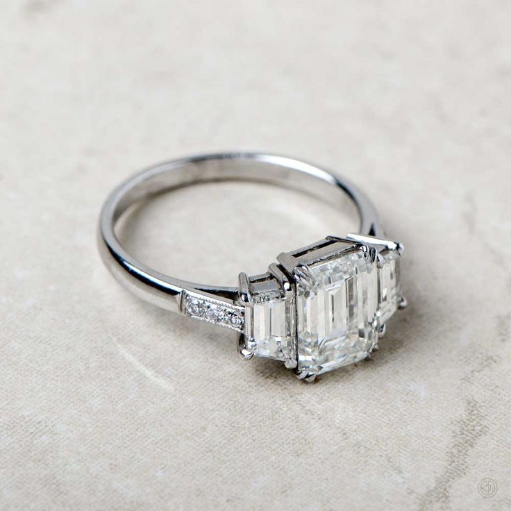 A stunning Emerald Cut Diamond Engagement Ring. Set in a beautiful Platinum Mounting.