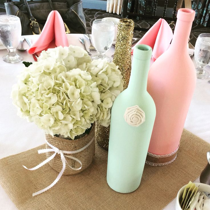 Wedding Shower Centerpieces   Chalk painted wine bottles, gold glitter dipped wine bottles, and mason jars wrapped in burlap with hydrangeas for a bridal shower.. All painting, decorating, and glitter products found at michael's.. Hydrangeas from Trader Joe's