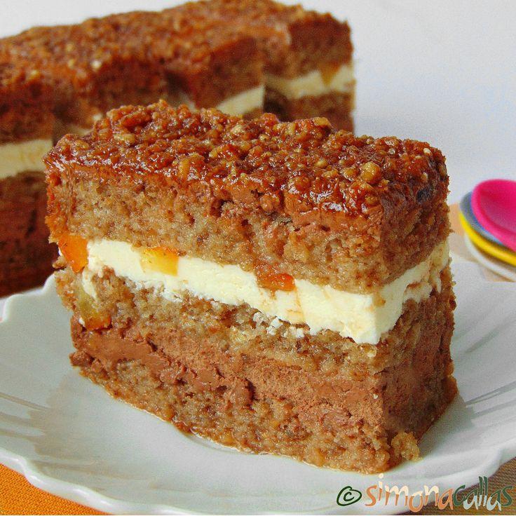 Prajitura Margot cu portocale krantz si ciocolata se compune din blat cu nucă însiropat, ganache de ciocolată, cremă de unt şi cranţ.