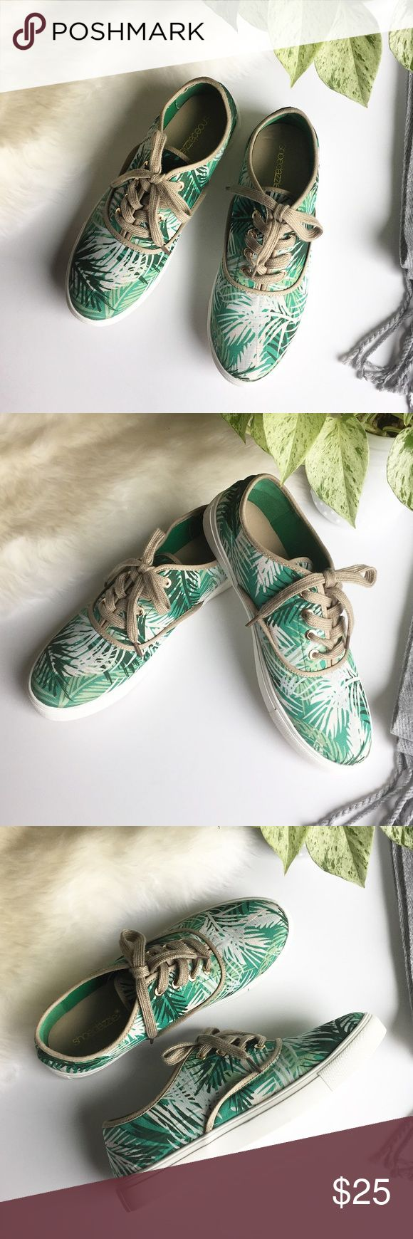 - SHOE DAZZLE - Palm Print Sneakers Classsic lace up sneakers get refreshed with a beach palm print so you can always be on the beach! Excellent pre-loved condition, no flaws.  🔸Bundle & Save 15% on 2+ items!                         🔸Free gift on purchases over $100!                    🙅🏼No trades / selling off of Posh.                          🌟Offers always welcome!🌟 (low-ball offer = counteroffer 😊) Shoe Dazzle Shoes Sneakers
