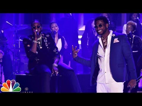 """2 Chainz touched down on The Tonight Show stage last night with Gucci Mane and Farnsworth Bentley in tow for a performance of """"Good Drank"""" backed by The Roots and a choir. Watch above and then click to watch them play """"Password"""" with Aaron Paul and Keri Russell below. 