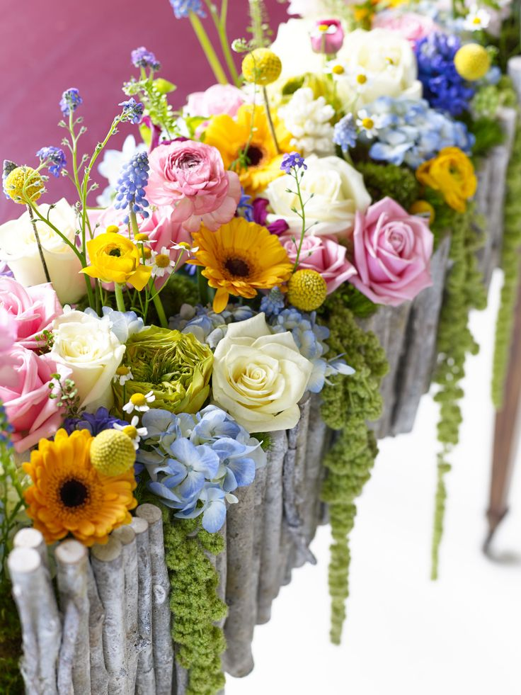 15 best spring weddings images on pinterest spring weddings spring flowers lined along a dining table mightylinksfo
