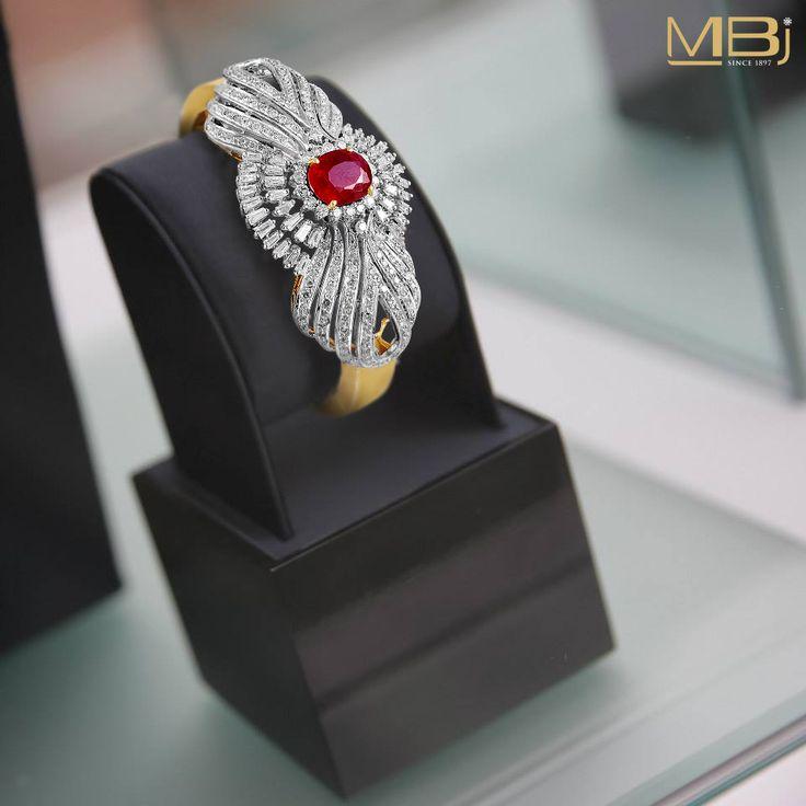 Diamond bracelet along with ruby and gold texture. #MBj #Luxury #Desirable #Modern #JewelleryLove #Bracelet