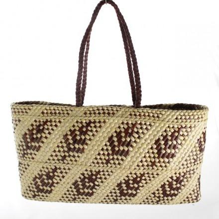 Kete whakairo (FJ164) ARTIST: FIONA JONES Hand woven brown and natural fern pattern kete with muka (flax fibre) handles.
