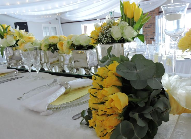 Main table in yellow with a 'throw bouquet'