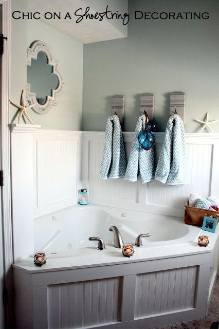 love this corner tub with board and batten-beach coastal bathroom by Chic on a Shoestring Decorating