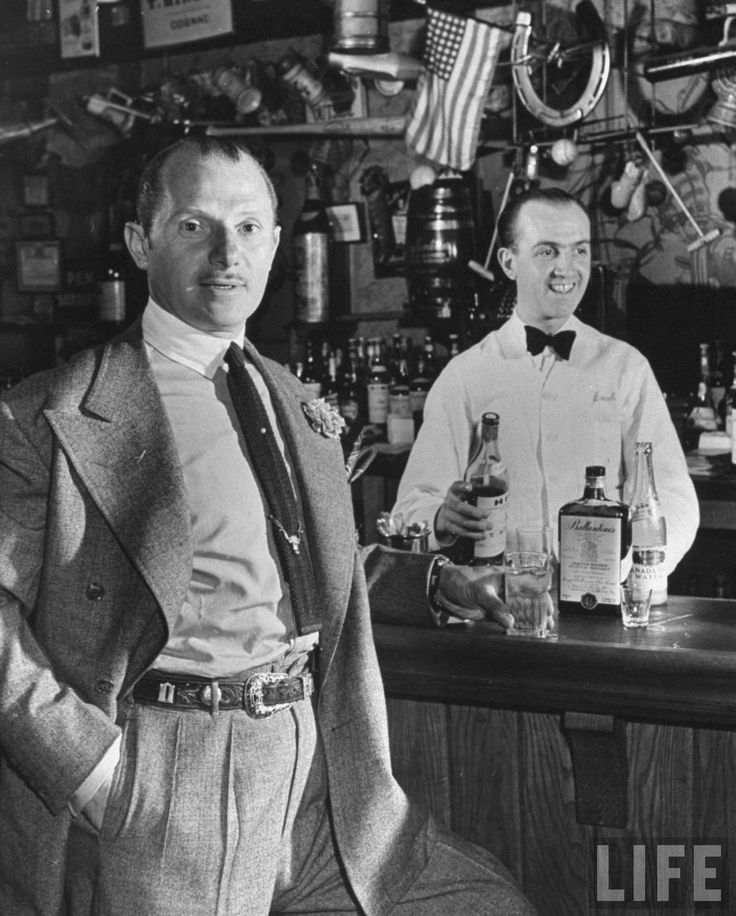 "21 Club co-founder Jack Kriendler standing at the bar in 1941 (via LIFE).  Too many champagne lunches at ""21"""