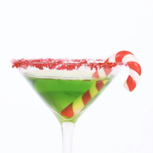 The Grinch    Mix a shot of Midori with a shot of vodka in a highball glass, and top off with sour mix. If you don't want to be too bah-humbug, simplygarnish the beverage with a candy cane. After all, while he started off as a sour puss, he did come around by the end.