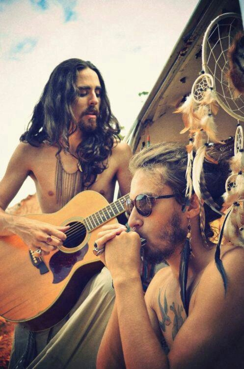 hippie gypsy men...would i rock a feathered ear ring? yes I would thank you very much!