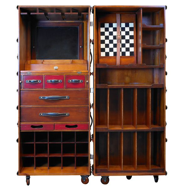 Bar in the Trunk, Black  -  Trunk bar features a multitude of drawers, two serving trays, racks for both horizontal and vertical bottles. Mirror and foldout work shelf. Taking out the shelf unit on the right frees up a removable game board. Future party animal cum classic trunk replica. Iconic. Confidently evocative of the Belle Époque when a hunt required only a Martini or a whiskey sour at hand!