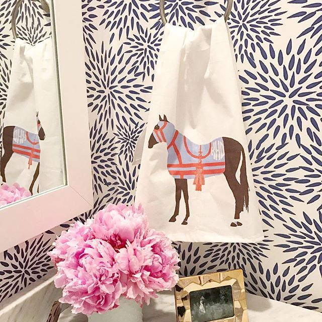 Our monogrammed hand towel in our horse print against our mums the word wallpaper. #katiekimeprints