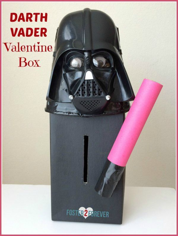 Check out this Star Wars Valentine box for boys made out of a shoebox, popcorn tub, duct tape, toilet paper rolls, construction paper, and a mask. #diy #craft