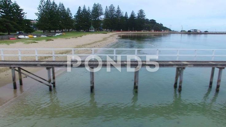 Fast sideways flight parallel to Sorrento Long Pier with quick turn - Stock Footage | by gregbrave