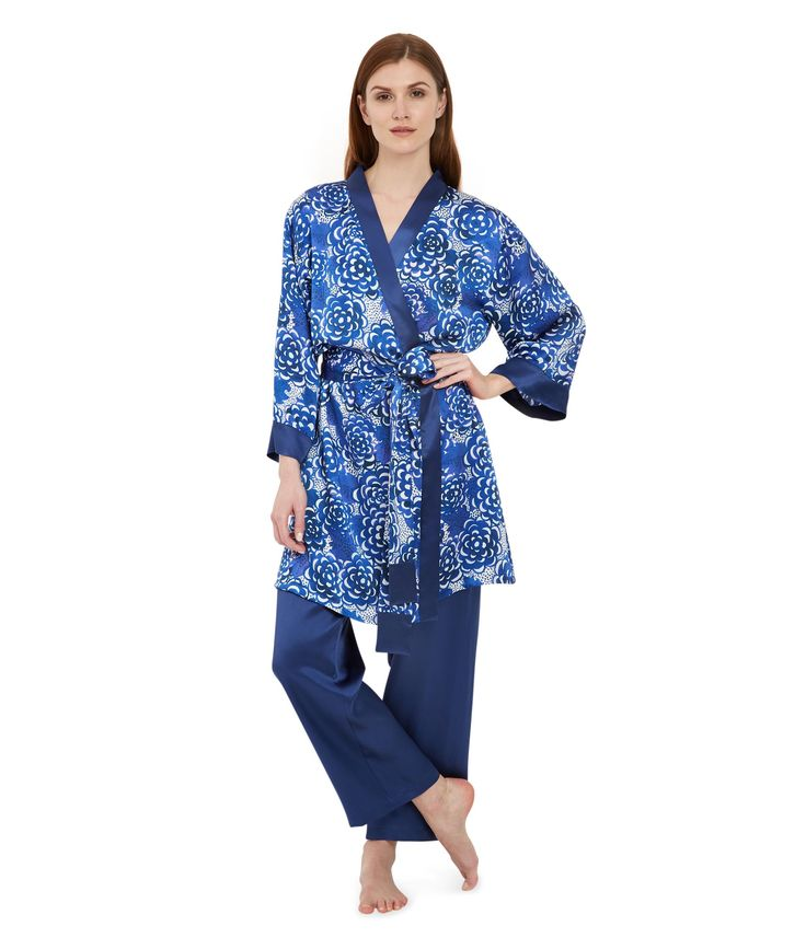 Lotus Silk Robe £500 - The wonderfully flattering blue floral silk robe was inspired by the classic wrap dress, famed for its elegant lines and perfect fit. Our silk robes have flared, bracelet length sleeves with a deep, contrast cuff in indigo blue and the long wide belt, also with contrast detail, ties off to the side.