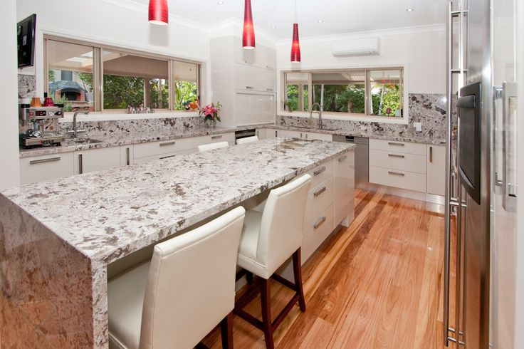 Double thick benchtop with waterfall edge. www.onecallkitchens.com.au
