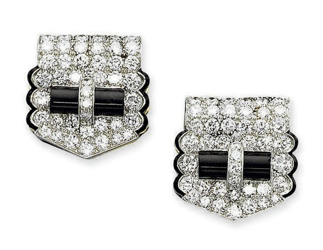 A pair of art deco onyx and diamond clips by cartier each for Palm beach jewelry catalog request