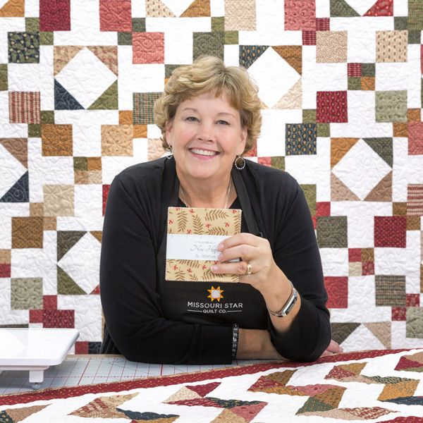 Join Jenny as she works her sewing magic and creates the dynamic Nine Patch Madness Quilt!
