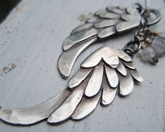 "Silver wings--evocative of ""Wings of Desire"" & ASCAR, i.e., all of the remaining Crow & Raven aficionados."