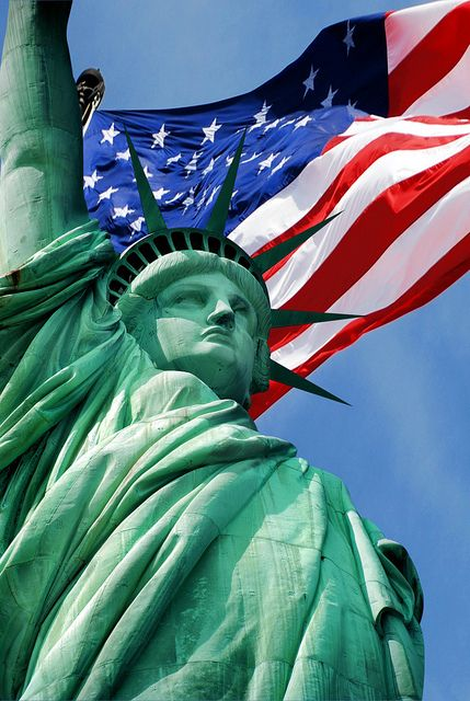Old Glory soaring over Lady Liberty (The Statue of Liberty), New York City -------  (by subjectivexperience)