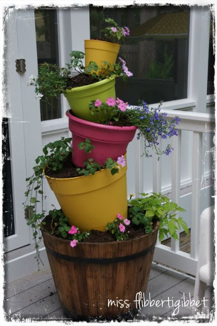 Cute Garden Ideas From My Daughter - Miss Flibbertigibbet - I like the addition of the colored pots.  Something to mull over for next year.  :)