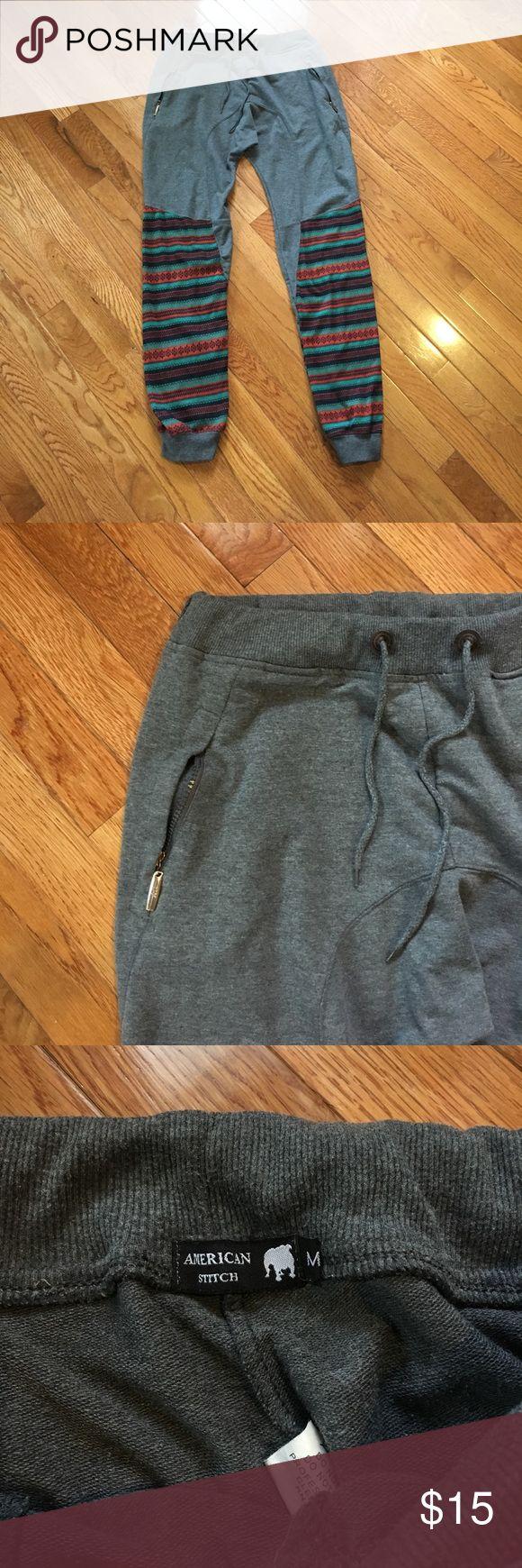 Grey and Aztec design joggers Men's Small grey and Aztec design joggers. Have draw string to tighten. Zipper pockets. Pants Track Pants & Joggers