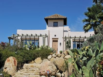 4670 Pennell Rd, Santa Barbara, California...Southwest Style. 5br/3.5bth. Family Room/Den. Office Area. Approximately 4,667 sf. 1 acre very usable lot. Ocean View. Mountain View. Wrap around deck. Apprx. 25' ceiling height in foyer. Rest of home 10-14' high ceilings. Excellent, unique Southwestern Finishes, architectural elements. Lots of Natural Light. Airy. Oak Trees. 4 Car Garage. Expansive patio for entertaining off Kitchen above garage.