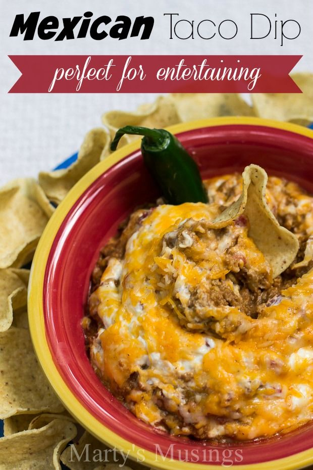 This easy Mexican Taco Dip recipe is perfect for parties, sports events and even potluck dinners. This easy throw together recipe from Marty's Musings will be a favorite with family and friends.
