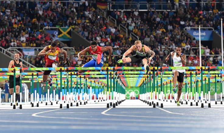 (FromL) Lebanon's Ahmad Hazer, Spain's Yidiel Contreras, Cuba's Yordan L. O'Farrill, Germany's Gregor Traber and Cayman Islands's Ronald Forbes compete in the Men's 110m Hurdles Round 1 during the athletics event at the Rio 2016 Olympic Games at the Olympic Stadium in Rio de Janeiro on August 15, 2016.   / AFP / OLIVIER MORIN