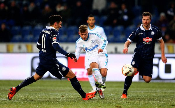 Max Meyer Photos Photos - Stepahn Salger (L) of Bielefeld and Max Meyer #7 of Schalke battle for the ball during the friendly match between Arminia Bielefeld and Schalke 04 at Schueco Arena on January 18, 2016 in Bielefeld, Germany. - Arminia Bielefeld v FC Schalke 04  - Friendly Match