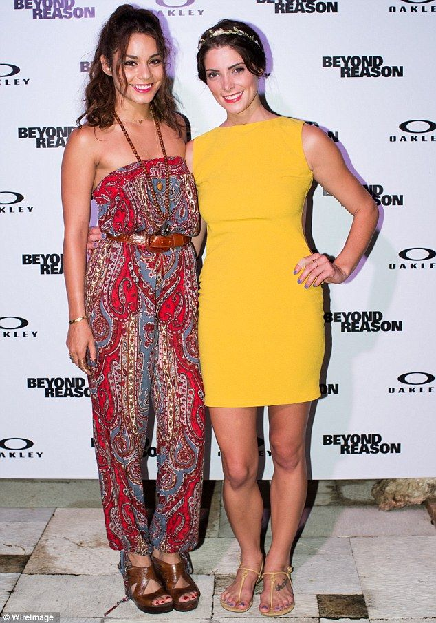 Bohemian: Vanessa wore a paisley jumpsuit with platform heels while Ashley looked bright in her tight yellow frock and T-strap sandals