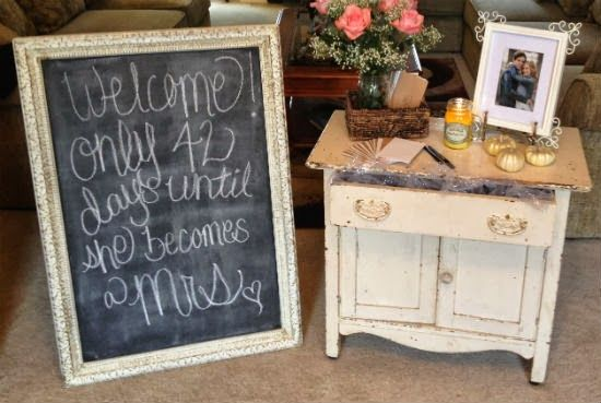 I like the sign idea along with an engagement photo on a table to fill out address envelopes.