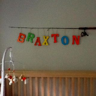 hang his fishing poles in X's room - with out the letters and high up so not easily grabbed.  Or use to hang art...