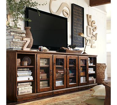 I like how the TV Is NOT on the stand but hung on wall.   I can live with this.  I also like all the stuff around it.  Printer's Long Low Media Suite #potterybarn