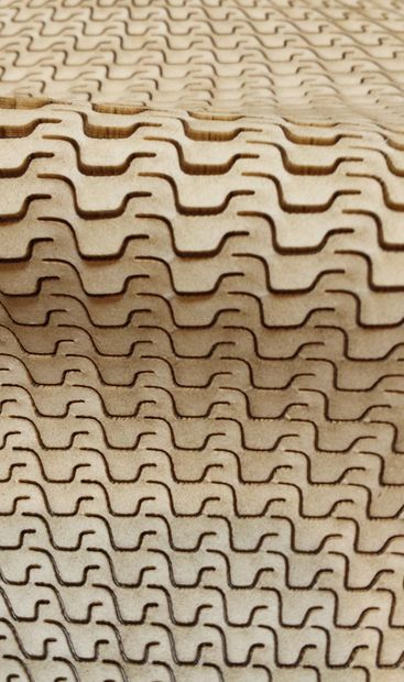 Lasering wood to create flexible materials. Towards the end, gets into parametrically varying cut density to create curves.