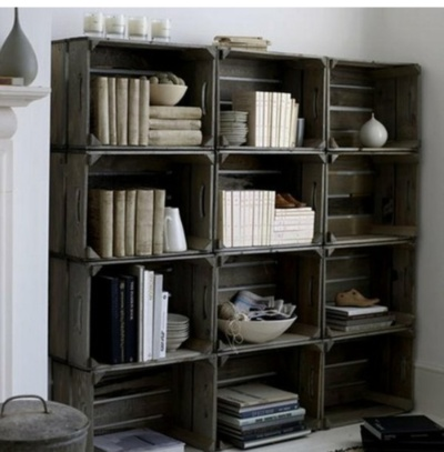 crate bookshelfs in basement for toy storage